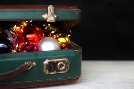 decorations for the holiday in a suitcase on a dark background / toys for adults
