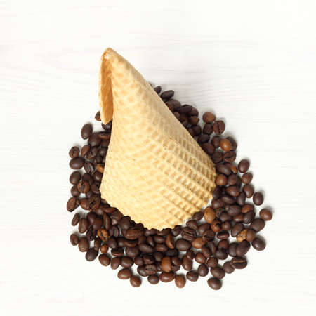 inverted waffle cone with spilled grains top view / joke coffee ice cream