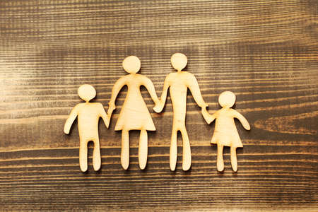 wooden silhouette mockup family holding hands together. two parents with children