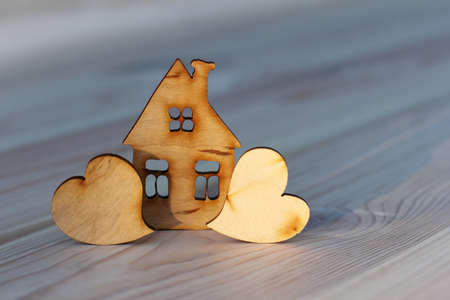 mock up of a wooden house along with a pair of hearts nearby.cute sweet home Reklamní fotografie