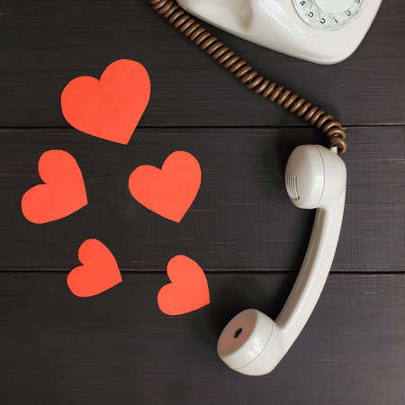 red hearts fly out of the handset. talk of love