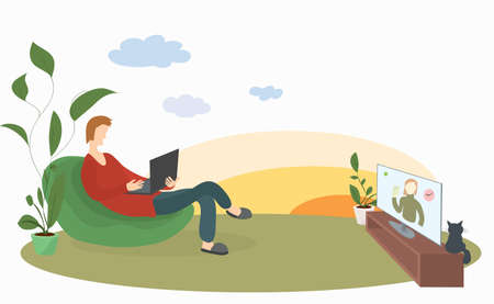 man with a laptop in a soft chair on the lawn conveniently watches news on TV. remote work and outdoor recreation