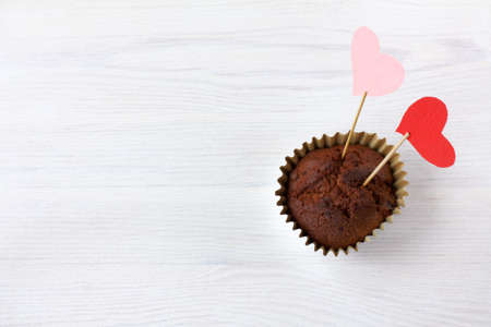 chocolate muffin decorated with a pair of hearts. very sweet love to eat Reklamní fotografie