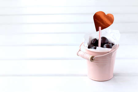 bucket of chocolates decorated with a heart symbol. sweet holiday gift