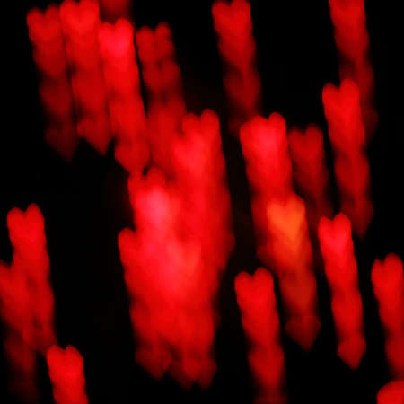 Blurry glowing luminous silhouettes of hearts. red on black Reklamní fotografie