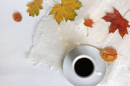 cup of black coffee on the festive table top view. little break on autumn weekend