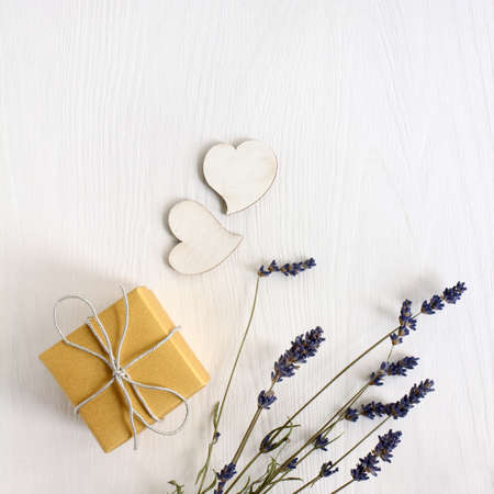 gift with a bouquet of lavender and a pair of hearts top view. holiday of lovers