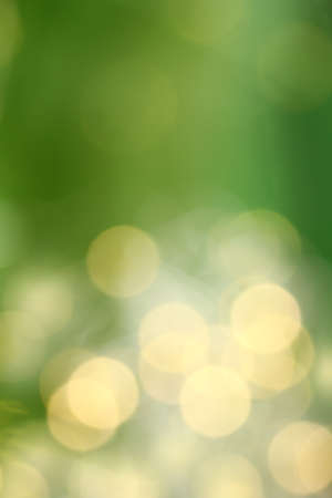 Abstract blurry lights in yellow and green colors. summer warming background Foto de archivo