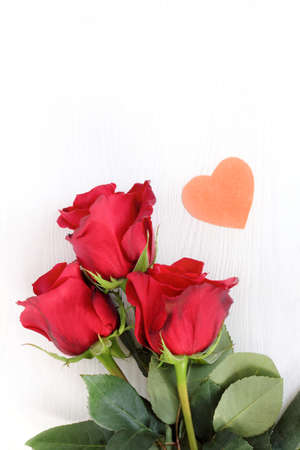 bouquet of roses and a small heart. tender love greetings