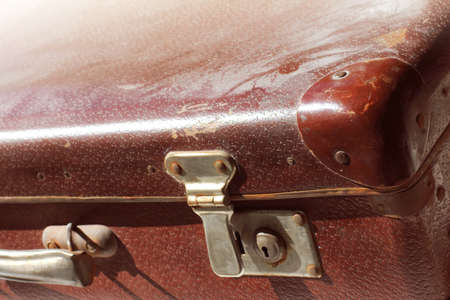 old dust and rust covered suitcase closeup. when travel is delayed for a long time