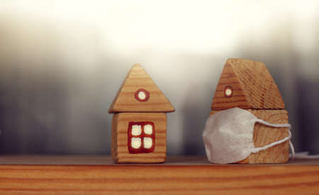 two wooden houses, one of which is masked. personal protection