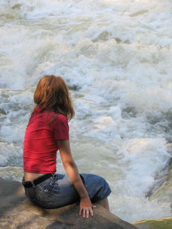 girl sitting on a stone and looking at boiling stream Stock Photo - 817687