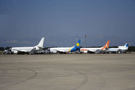 airplanes on a runway of international airport terminal Stock Photo