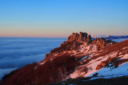 Demerdji Peak with clouds at sunrise photo