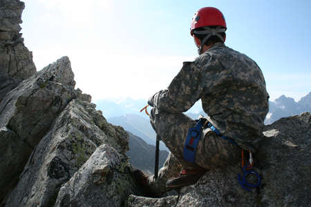 climber sitting on a rock and looking at mountain panorama Stock Photo - 1685697