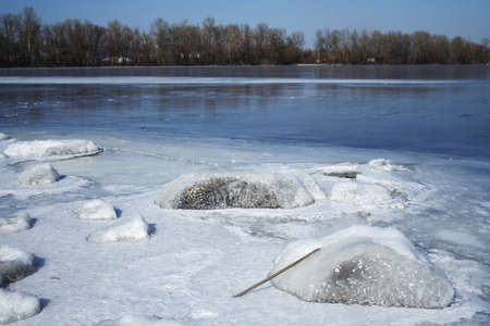 iced stone and frozen river at background Stock Photo - 1727734