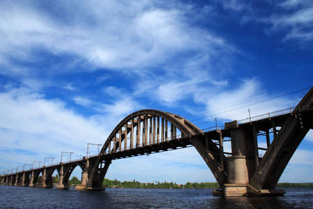 concrete railroad bridge with arches photo
