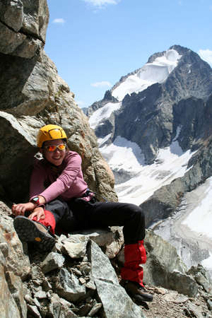 happy girl climber sitting on a rock and smiling Stock Photo - 1907068