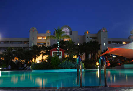 hand-rails to the night illuminated swimming pool  Stock Photo