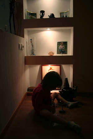 ennui: girl sitting on a floor at lonely room and dreaming