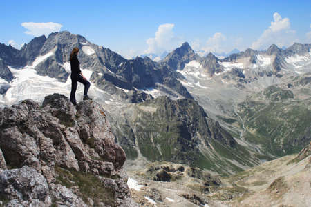 girl standing at the edge of rock Stock Photo - 2262128