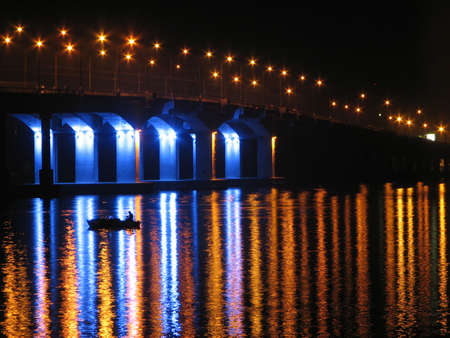 night river bridge lighted by the lamps photo