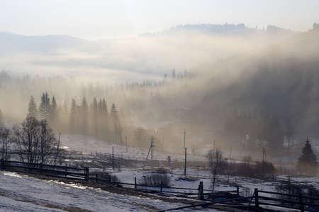 misty morning at mountain village photo