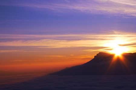 mountain ridge with high cloudness at sunset time. Babugan, Crimea, Ukraine