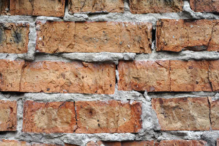 dilapidated: brick wall background. Dilapidated building  Stock Photo