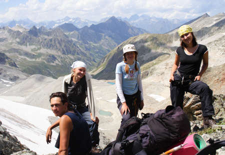 group of hikers taking a rest after rising Stock Photo - 3400306