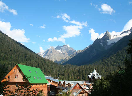 dombai: mountain village with wooden houses. Dombai, Caucasus, Russia  Stock Photo