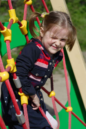smiling little girl at the playground photo