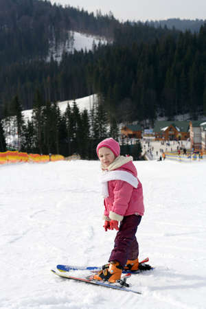 portrait of young girl skier with snowed hill at background Stock Photo - 3627128