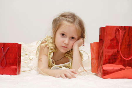 sad girl just received her gifts looking at you  Stock Photo