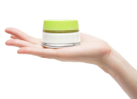 woman hand holding a container full of cream