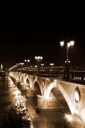 night view of ancient stone bridge at the retro style  photo
