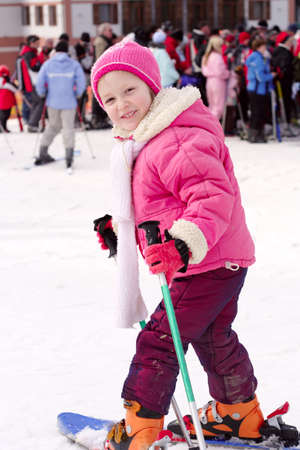 portrait of young girl skier with blurred crowd of skiers at background Stock Photo - 4242094