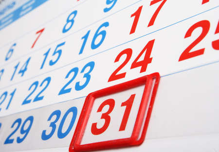 ufficio di calendario con l'indice su un ultimo giorno del mese Archivio Fotografico