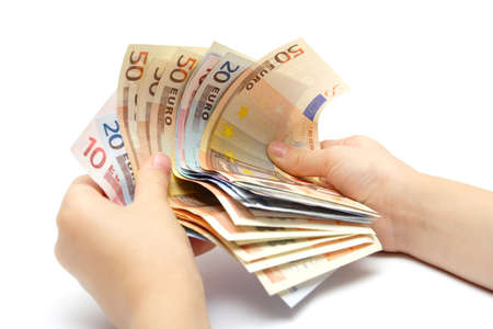 batch of euro: child hands holding a batch of euro banknotes