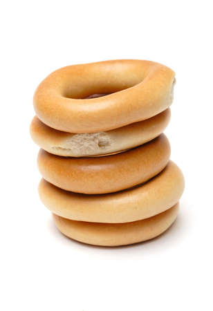 boublik: stack of appetizing bagels on a white background