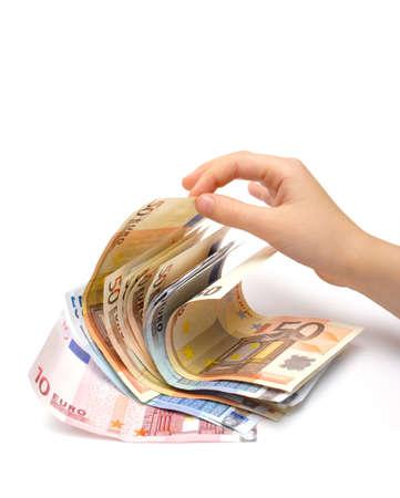 batch: hijo `s pellizcos una parte de los billetes en euros el lote Foto de archivo