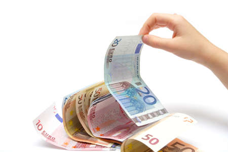 batch of euro: child`s hand pinching  a euro banknotes from the batch