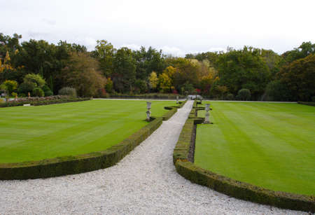 grassplot: gravel foot-path stretching through the big grass-plot