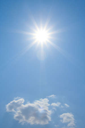 sun flare: bright sun above the cloud is lighting right to the camera  Stock Photo