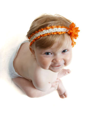 frontlet: close-up portrait of child with orange frontlet on her head
