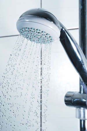 drops dripping from the shower-bath. Frozen motion