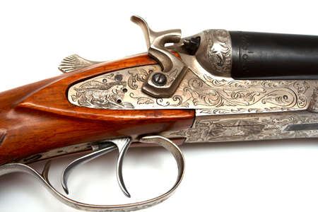trigger of old-fashioned classic style rifle made of silver  Stock Photo