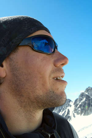 ultimate: hiker high at the mountains looks at the ultimate aim of his trip. It is reflected at his glasses