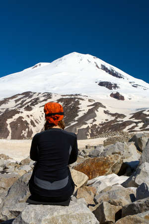 ultimate: girl hiker high at the mountains looks at the ultimate aim of his trip  Stock Photo