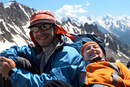 two hikers taking a rest after rising  photo